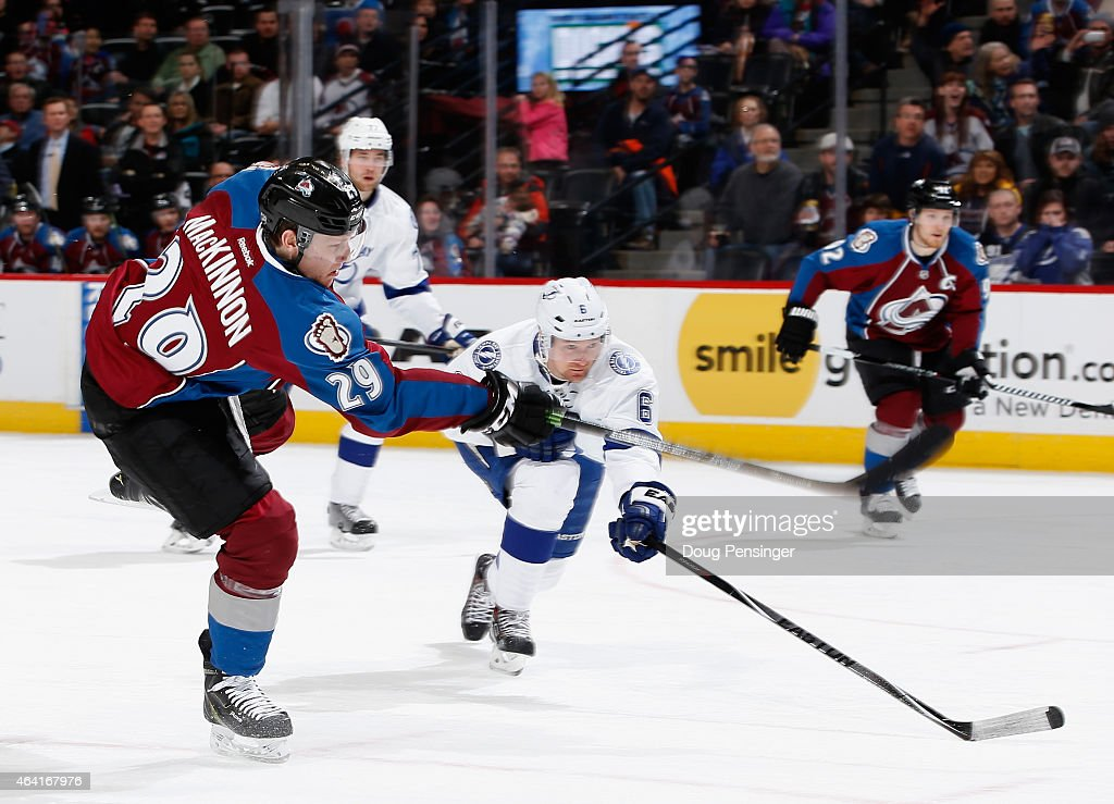 Nathan MacKinnon #29 of the Colorado Avalanche gets off a shot against Anton Stralman #6 of the Tampa Bay Lightning for his third goal of the game to give the Avalanche a 4-2 lead with his hat trick in the second period at Pepsi Center on February 22, 2015 in Denver, Colorado.