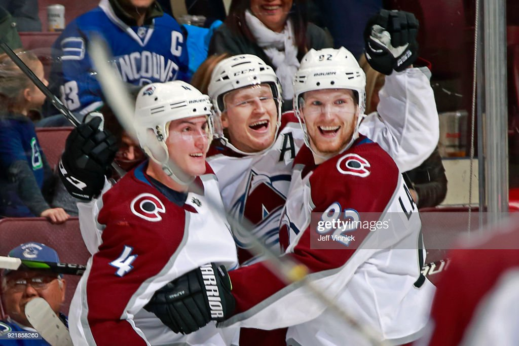 Nathan MacKinnon #29 of the Colorado Avalanche is congratulated by teammates after scoring during their NHL game against the Vancouver Canucks at Rogers Arena February 20, 2018 in Vancouver, British Columbia, Canada. Colorado won 5-4.
