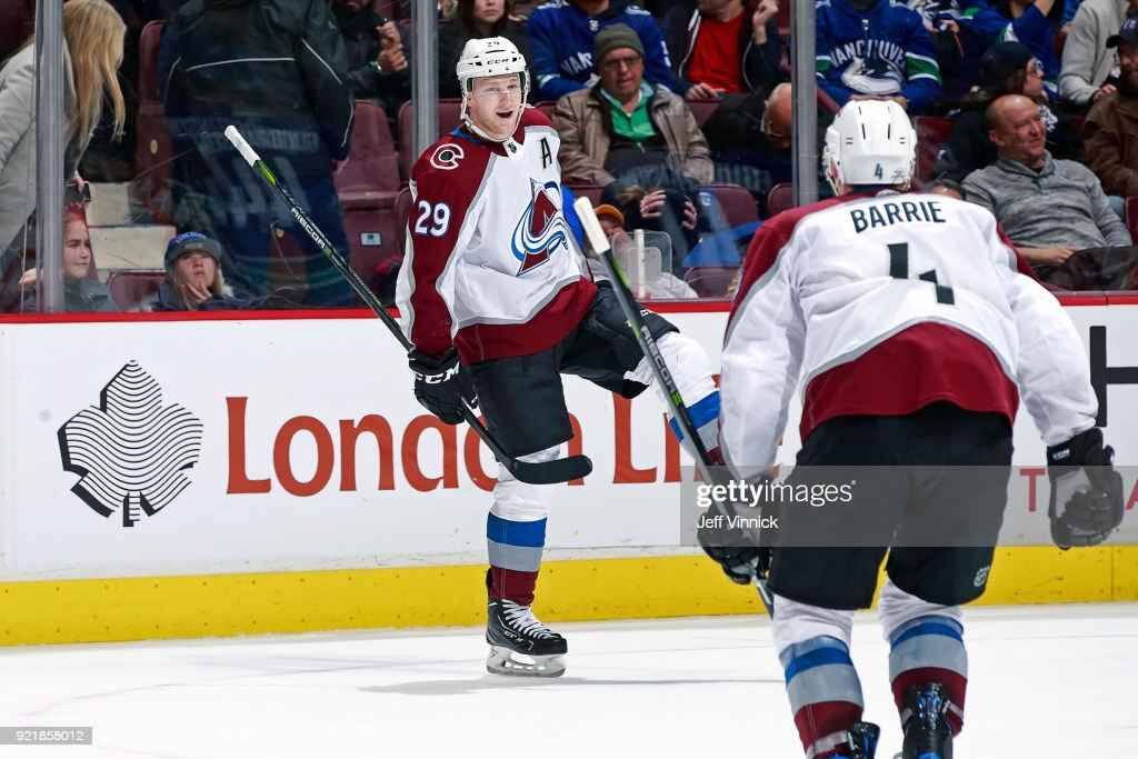 Nathan MacKinnon #29 of the Colorado Avalanche is congratulated by teammate Tyson Barrie #4 after scoring his game winning goal during their NHL game at Rogers Arena February 20, 2018 in Vancouver, British Columbia, Canada. Colorado won 5-4.