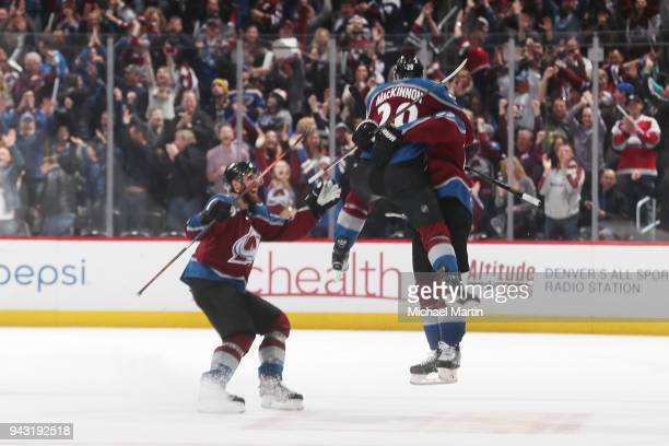 Nathan MacKinnon of the Colorado Avalanche jumps onto teammate Gabriel Landeskog after he scored a goal against the St Louis Blues at the Pepsi...