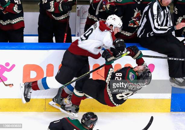 Nathan MacKinnon of the Colorado Avalanche knocks over Jordan Oesterle of the Arizona Coyotes during the third period in Game Three of the Western...