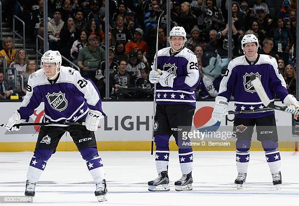 Nathan MacKinnon of the Colorado Avalanche Patrik Laine of the Winnipeg Jets and Ryan Suter of the Minnesota Wild look on during the Central Division...