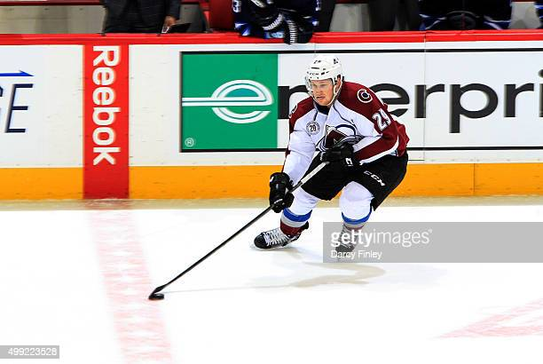 Nathan MacKinnon of the Colorado Avalanche plays the puck up the ice during secondperiod action against the Winnipeg Jets at the MTS Centre on...