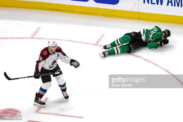 Nathan MacKinnon of the Colorado Avalanche reacts as he is called for an interference penalty after hitting Corey Perry of the Dallas Stars during...