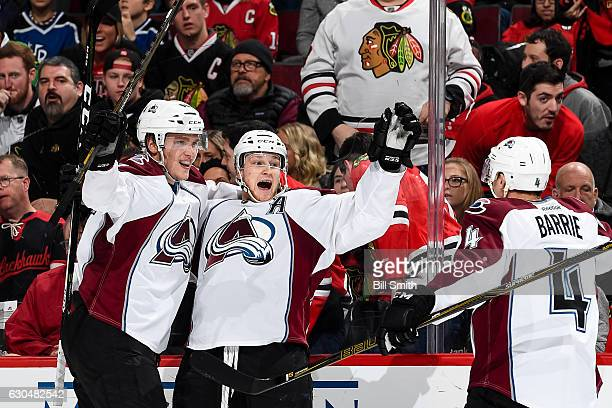 Nathan MacKinnon of the Colorado Avalanche reacts with Mikko Rantanen after scoring the game winning goal in overtime against the Chicago Blackhawks...