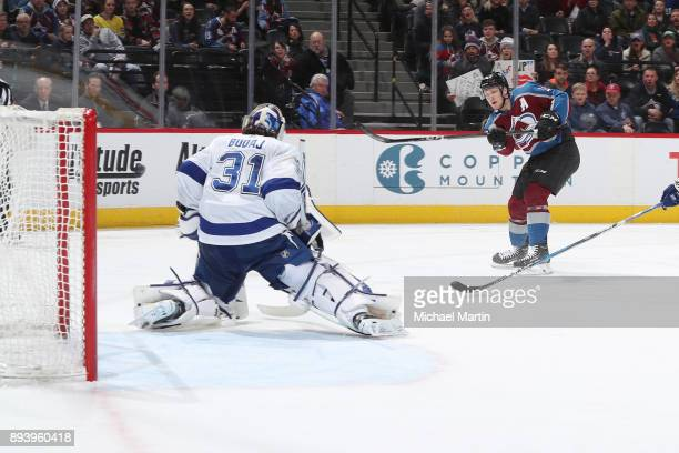 Nathan MacKinnon of the Colorado Avalanche scores against goaltender Peter Budaj of the Tampa Bay Lightning at the Pepsi Center on December 16 2017...