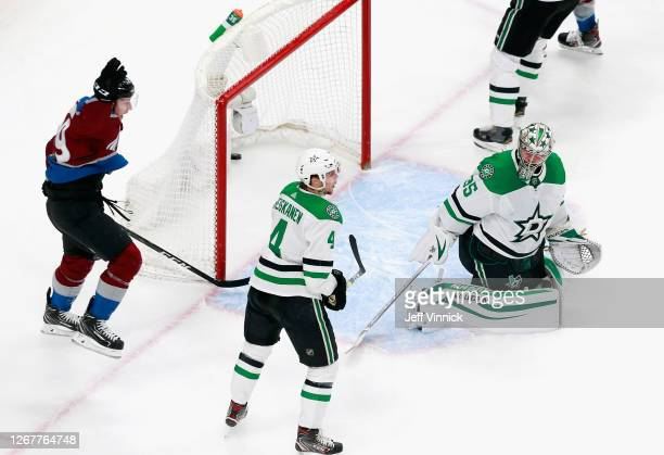 Nathan MacKinnon of the Colorado Avalanche scores at 18:29 of the second period against Anton Khudobin of the Dallas Stars in Game One of the Western...