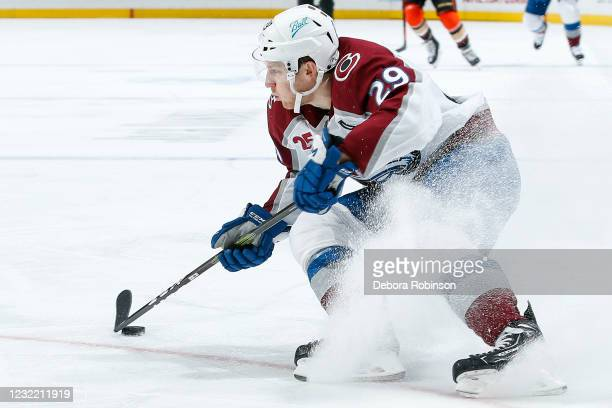 Nathan MacKinnon of the Colorado Avalanche skates with the puck in the first period against the Anaheim Ducks at Honda Center on April 09, 2021 in...