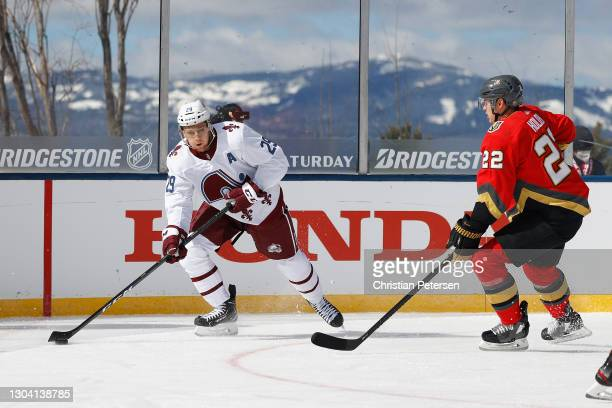 Nathan MacKinnon of the Colorado Avalanche skates with the puck against the Vegas Golden Knights during the 'NHL Outdoors At Lake Tahoe' at the...