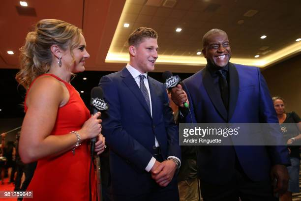 Nathan MacKinnon of the Colorado Avalanche speaks with NHL Network sportscasters Jamie Hersch and Kevin Weekes as MacKinnon arrives at the 2018 NHL...