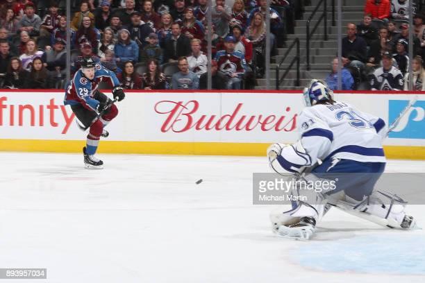 Nathan MacKinnon of the Colorado Avalanche takes a shot against goaltender Peter Budaj of the Tampa Bay Lightning at the Pepsi Center on December 16...