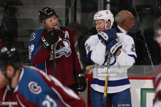 Nathan MacKinnon of the Colorado Avalanche talks to Jonathan Drouin of the Tampa Bay Lightning prior to the game at the Pepsi Center on February 19...