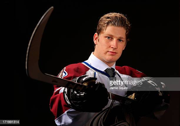 Nathan Mackinnon poses for a portrait after being selected number one over all in the first round by the Colorado Avalanche during the 2013 NHL Draft...