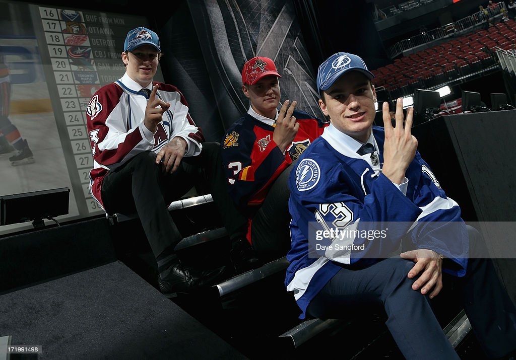 Nathan MacKinnon selected first overall by the Colorado Avalanche, Aleksander Barkov selected second overall by the Florida Panthers and Jonathan Drouin selected third overall by the Tampa Bay Lightning pose together during the 2013 NHL Draft at Prudential Center on June 30, 2013 in Newark, New Jersey.
