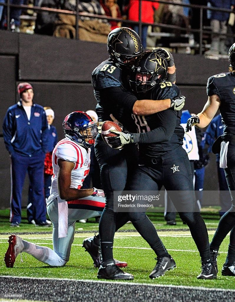 Nathan Marcus #83 of the Vanderbilt Commodores congratulates teammate Bailey McElwain #39 on scoring a touchdown against the Ole Miss Rebels during the second half at Vanderbilt Stadium on November 19, 2016 in Nashville, Tennessee.