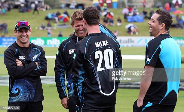 Nathan McCullum Corey Anderson Adam Milne and Jesse Ryder of New Zealand share a joke during the rain delay prior to game three of the One Day...