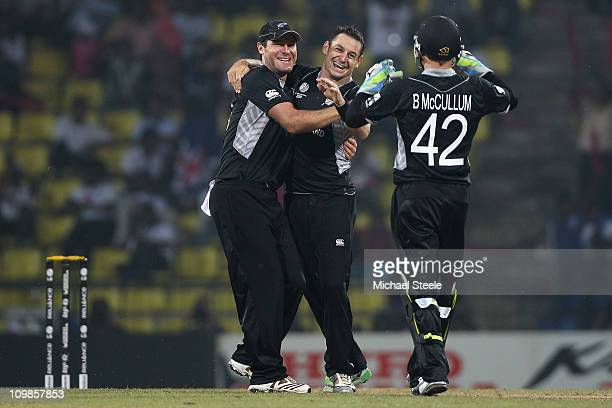 Nathan McCullum of New Zealand celebrates taking the wicket of Abdur Rehman with Brendon McCullum and Jamie How during the New Zealand v Pakistan...
