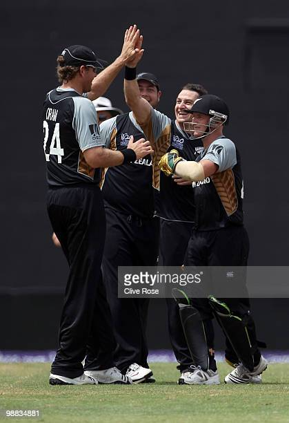 Nathan McCullum of New Zealand celebrates the wicket of Craig Ervine of Zimbabwe during the ICC T20 World Cup Group B match between New Zealand and...