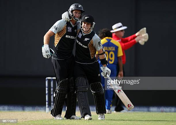 Nathan McCullum of New Zealand celebrates with Tim Southee after hitting the winning runs in the ICC T20 World Cup Group B match between Sri Lanka...