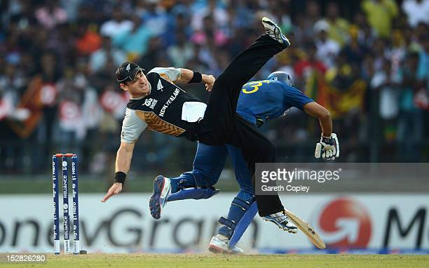 Nathan McCullum of New Zealand collides with Tillakaratne Dilshan of Sri Lanka during the ICC World Twenty20 2012 Super Eights Group 1 match between...