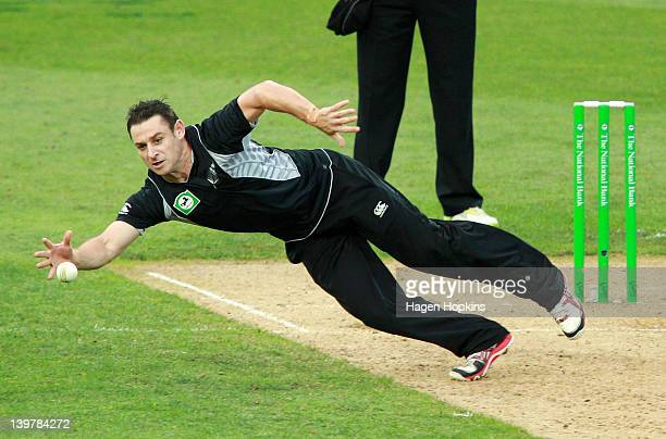 Nathan McCullum of New Zealand fields a ball off his own bowling during the One Day International match between New Zealand and South Africa at...