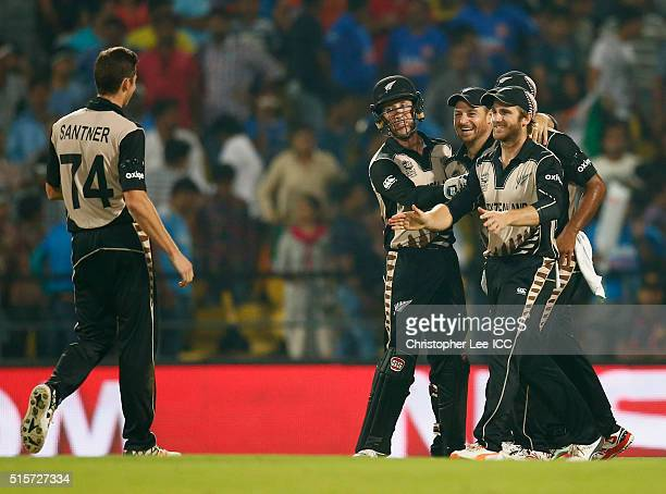 Nathan McCullum of New Zealand is congratulated by his team mates after he catches out MS Dhoni Captain of India during the ICC World Twenty20 India...
