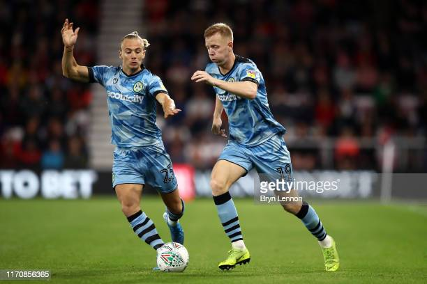 Nathan McGinley and Junior Mondal of Forest Green Rovers in action in the Carabao Cup Second Round match between AFC Bournemouth and Forest Green...