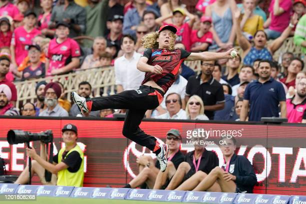 Nathan McSweeney of the Renegades drops a Steve Smith shot on the boundary during the Big Bash League match between the Sydney Sixers and the...
