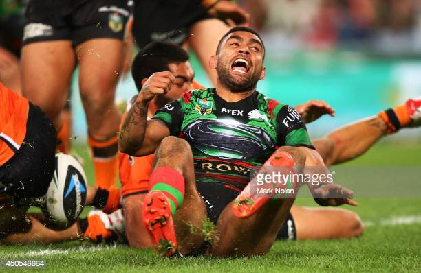 Nathan Merritt of the Rabbitohs celebrates scoring a try during the round 14 NRL match between the South Sydney Rabbitohs and the Wests Tigers at ANZ...