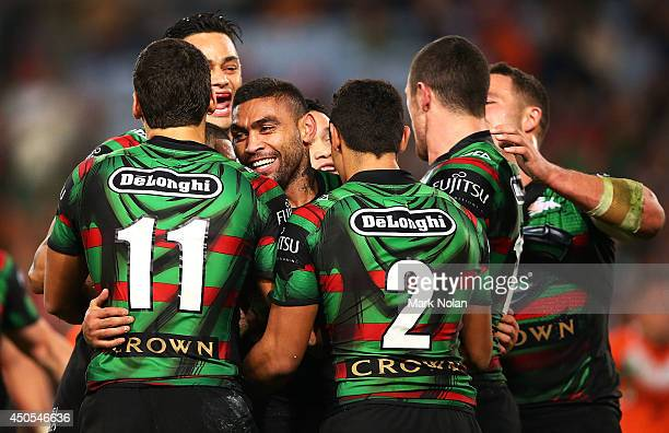 Nathan Merritt of the Rabbitohs celebrates with team mates after scoring during the round 14 NRL match between the South Sydney Rabbitohs and the...