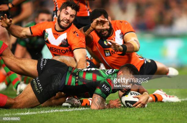 Nathan Merritt of the Rabbitohs dives to score a try during the round 14 NRL match between the South Sydney Rabbitohs and the Wests Tigers at ANZ...