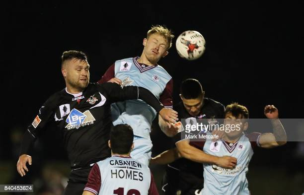Nathan Millgate of APIA Leichhardt Tigers wins a header during the round of 16 FFA Cup match between Blacktown City and APIA Leichhardt Tigers at...