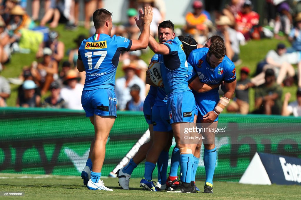 Nathan Milone of Italy celebrates a try during the 2017 Rugby League World Cup match between Ireland and Italy at Barlow Park on October 29, 2017 in Cairns, Australia.
