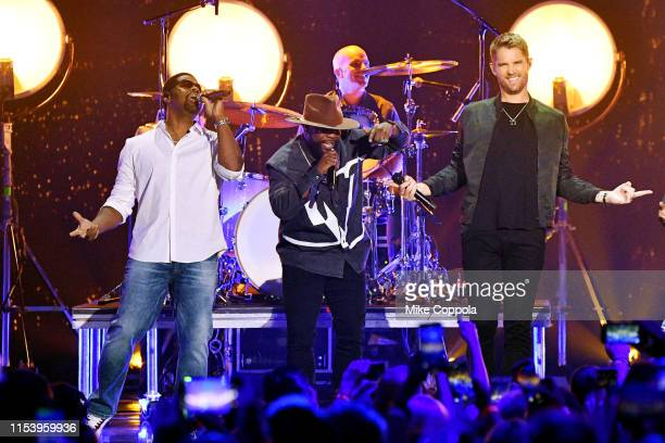 Nathan Morris and Wanya Morris of Boyz II Men and Brett Young perform at the 2019 CMT Music Awards at Bridgestone Arena on June 05 2019 in Nashville...