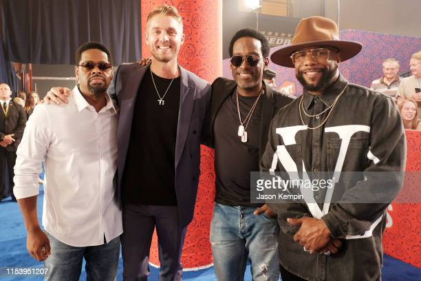 Nathan Morris Shawn Stockman and Wanya Morris of Boyz II Men with Brett Young attend the 2019 CMT Music Award at Bridgestone Arena on June 05 2019 in...