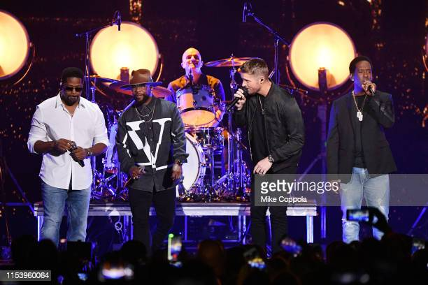Nathan Morris Wanya Morris and Shawn Stockman of Boyz II Men and Brett Young perform at the 2019 CMT Music Awards at Bridgestone Arena on June 05...