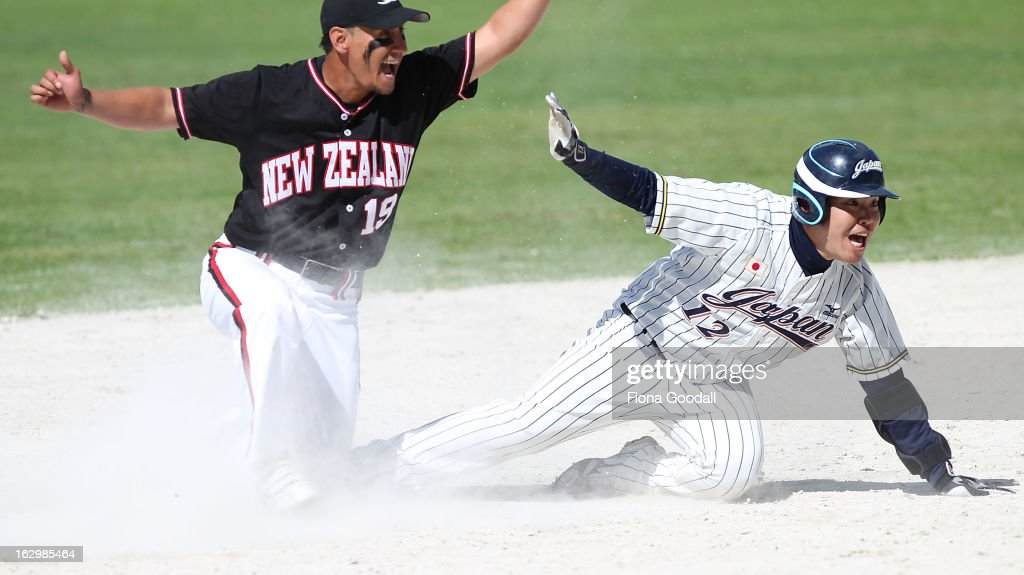 Nathan Nukunuku appeals for an out on base three with Japan's Saeki Tadaaki during the pool B match between New Zealand Black Sox and Japan at Rosedale Park, Albany on March 3, 2013 in Auckland, New Zealand.