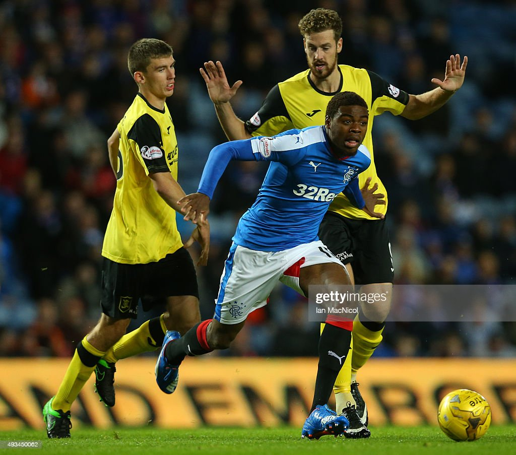 Nathan Oduwa of Rangers evades Jordan White of Livingston during the Petrofac Training Cup Quarter-Final match between Rangers and Livingston at Ibrox Stadium on October 20, 2015 in Glasgow, Scotland.