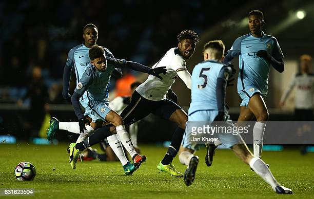 Nathan Oduwa of Tottenham Hotspur battles with Paolo Fernandes of Manchester City during the Premier League 2 match between Manchester City and...