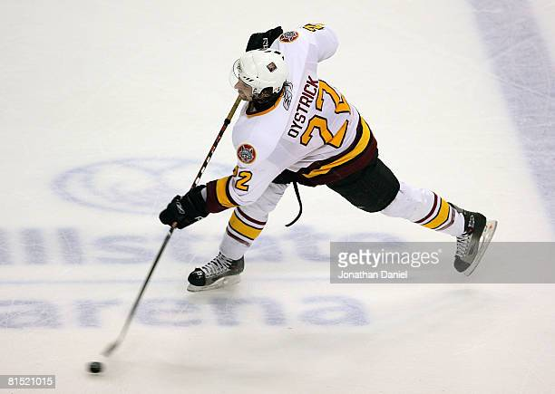 Nathan Oystrick of the Chicago Wolves fires a shot for a powerplay goal in the first period against the WilkesBarre/Scranton Penguins during the...