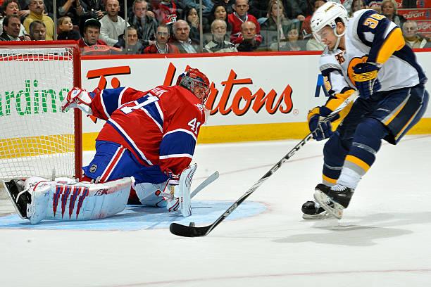 c254f417f Nathan Paetsch  38 of Buffalo Sabres takes goalie Jaroslav Halak  41 of the  Montreal