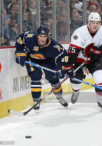 Nathan Paetsch of the Buffalo Sabres skates against Chris Neil of the Ottawa Senators on November 15, 2006 at HSBC Arena in Buffalo, New York.