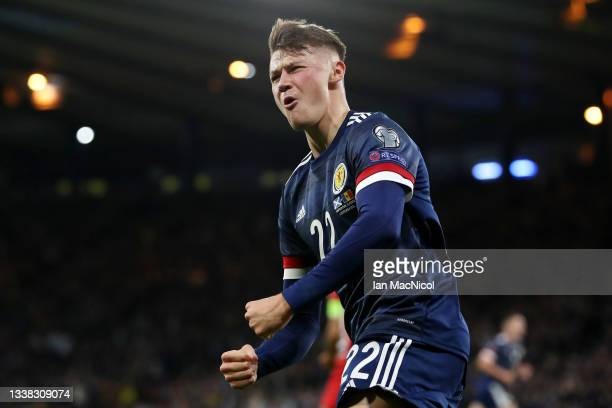 Nathan Patterson of Scotland celebrates their side's first goal scored by Lyndon Dykes of Scotland during the 2022 FIFA World Cup Qualifier match...