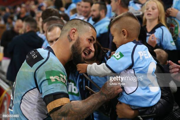 Nathan Peats of the Blues celebrates winning with his son during game one of the State Of Origin series between the Queensland Maroons and the New...