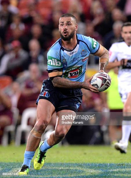 Nathan Peats of the Blues runs with the ball during game one of the State Of Origin series between the Queensland Maroons and the New South Wales...