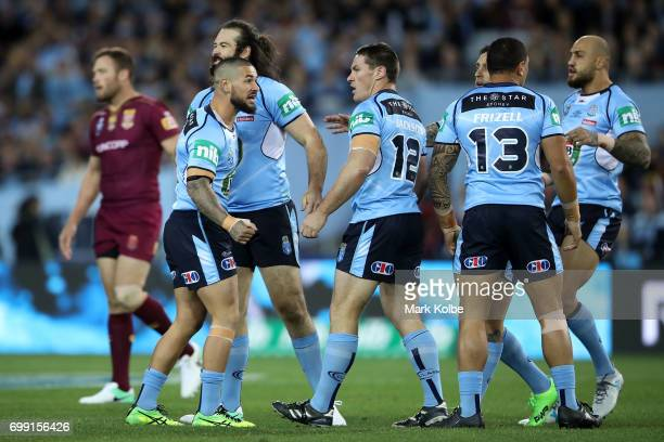 Nathan Peats of the Blues speaks to his team mates during game two of the State Of Origin series between the New South Wales Blues and the Queensland...