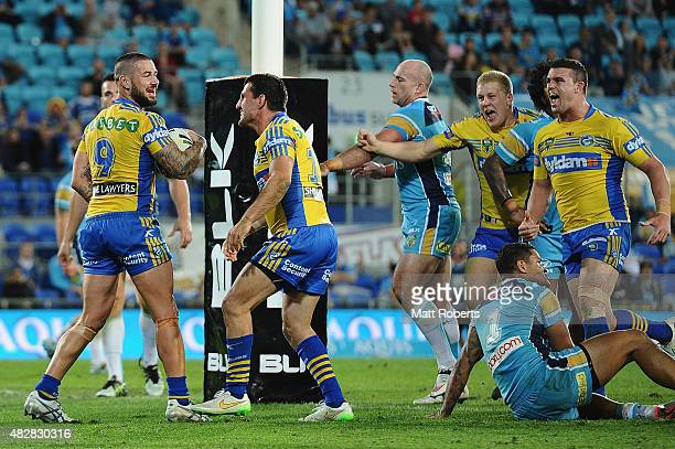 Nathan Peats of the Eels celebrates scoring a try with team mates during the round 21 NRL match between the Gold Coast Titans and the Parramatta Eels...