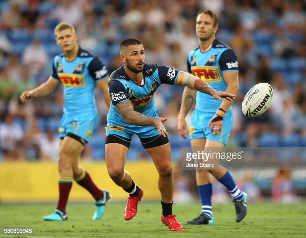 Nathan Peats of the Titans passes the ball during the round one NRL match between the Gold Coast Titans and the Canberra Raiders at Cbus Super...