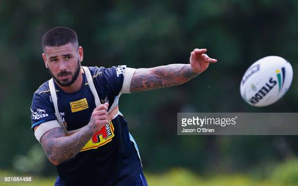 Nathan Peats passes the ball during a Gold Coast Titans NRL training session at Parkwood on March 14 2018 in Gold Coast Australia