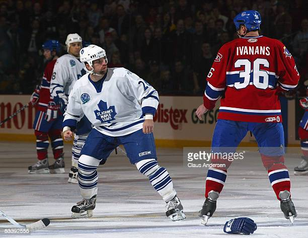 Nathan Perrott of the St John's Maple Leafs and Raitis Ivanans of the Hamilton Bulldogs square off during a American Hockey League game at Cobbs...